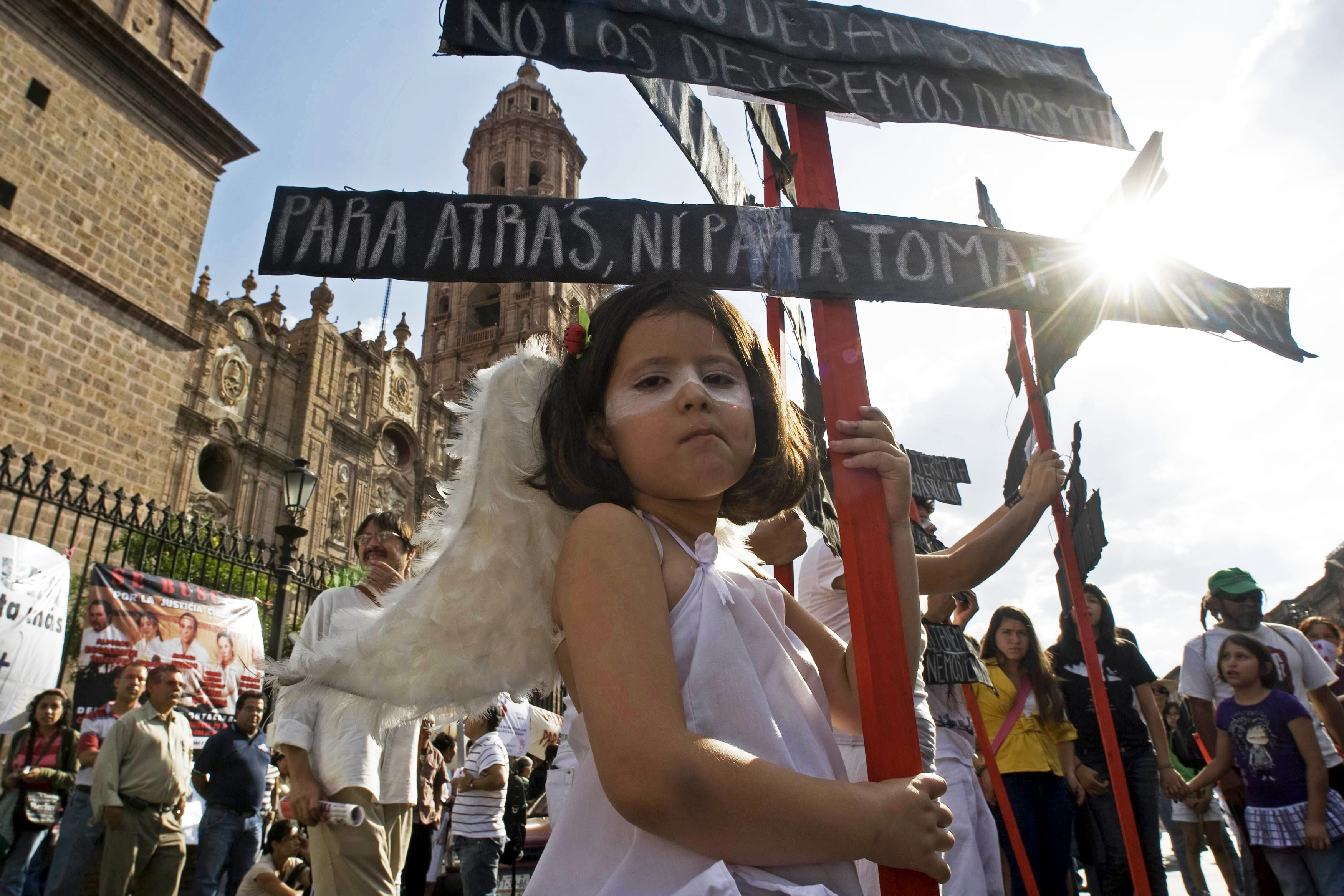 "Mexican children dress as an angel take part at the anti-violence rally ""Relief for Peace with Justice and Dignity"" caravan in the City of Morelia on June 4, 2011. The caravan - convened by the Mexican writer and poet Javier Sicilia to denounce the violence of crime in Mexico and to demand changes in the drug strategy - started in Cuernavaca and will cover 3,000 kilometers to finish in the border city of Ciudad Juárez. AFP PHOTO/ Porfirio GONZALEZ (Photo credit should read PORFIRIO GONZALEZ/AFP/Getty Images)"