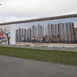 A photograph of the US-Mexican border by Kai Wiedenhöfer glued on the Berlin Wall. November 2012.