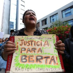 epa05193346 A protester holds a banner reading 'Justice for Berta' during a protest after the killing of indigenous leader and environmental activist Berta Caceres, in Guatemala City, Guatemala, 03 March 2016. Caceres, one of the founders of the The Civic Council of Popular and Indigenous Organizations of Honduras (COPINH) in 1993, opposed to the hydroelectric projects construction in the country to protect the environment. Cacers was killed on 03 March 2016, in the city of La Esperanza, Intibuca Department, Honduras.  EPA/ESTEBAN BIBA